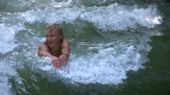 Germany Munich board surfer Swimmer swim against current Stock Footage