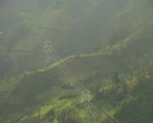 Electricity pylons on a misty Andean hillside - stock footage
