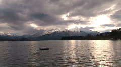 scenic of lake with mountains and clouds - stock footage