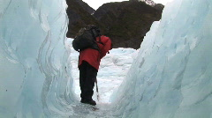 glacier tunnel with guide - stock footage