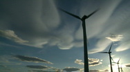 Stock Video Footage of Wind Turbines & Sun 7
