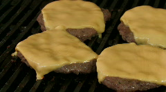 Cheese melting on burgers on bbq grill Stock Footage