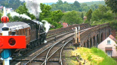 Steam train leaving station Stock Footage