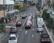 Cars on multi lane city street Stock Footage