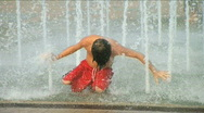 Boy Playing in Fountain Stock Footage