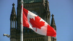 Canadian Flag And Parliament Building Peace Tower And Clock - stock footage