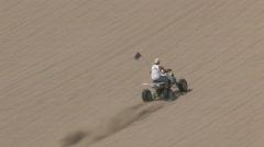 Four wheel ATV climb sand dune M HD - stock footage