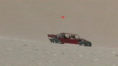 Dune buggy climb sand mountain M HD Stock Footage