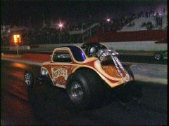 Motorsports, drag racing, Top fuel Altereds launch from start line Stock Footage