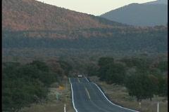 Vehicles on lonely Arizona Highway Stock Footage