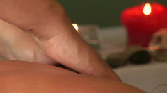 Woman at a spa health club getting a back massage - stock footage