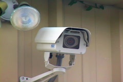 Mounted Security Camera Next To A Fog Light Stock Footage