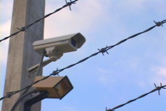 Security Camera Through Barbed Wire With Motion Sensor Stock Footage