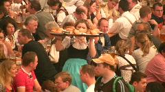 Munich beer festival Oktoberfest swilling fuddling drinking Stock Footage
