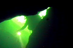 Cave Diver With Flashlight Exploring an Underwater Cave Scuba Diving - stock footage