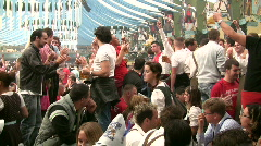 Munich beer festival Oktoberfest beer hall swilling fuddling drinking Stock Footage