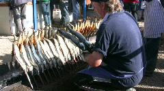 Germany Munich beer festival Oktoberfest grill fish in stick Stock Footage