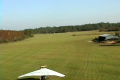 POV From Hang Glider Tree Tops to Grass Blades Flight and Landing Stock Footage