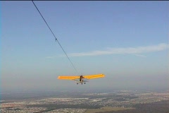 Aerial POV of an Ultralite Airplane Towing a Hang Glider Sky Stock Footage