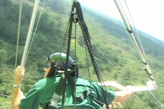 Reverse Shot of Solo Hang Glider Aerial POV Flying Flight Stock Footage