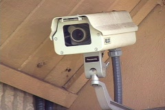 Security Camera Mounted on the Side of a Building Stock Footage