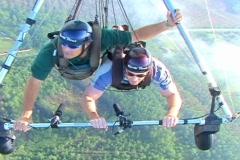 Tandam Hang Gliders Aerial POV Flight Flying Pilot Stock Footage