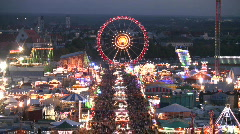 Big Wheel Carousel Munich beer festival Oktoberfest Germany crowded tourists  Stock Footage