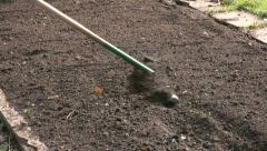 Trowel and hand fork used for gardening in early Spring garden park Stock Footage