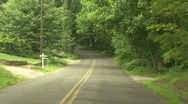 Stock Video Footage of Forest Road In Suburbia