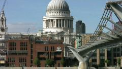 Zoom out from St Pauls cathedral across the river Thames London England - stock footage