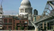 Stock Video Footage of Zoom out from St Pauls cathedral across the river Thames London England