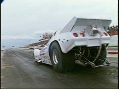 Motorsports, drag racing, white corvette funny car launch Stock Footage