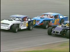 Motorsports, IMCA late models follow out of corner Stock Footage