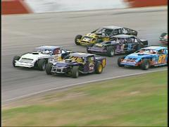 Motorsports, IMCA modified race into turn 2 Stock Footage