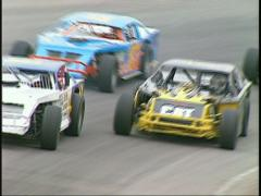 Motorsports, IMCA modifieds in corner tight follow out Stock Footage