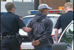 crime and justice, police arrest anonymous suspect led away in handcuffs - stock footage