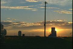 Sunset behind wheat elevator, prairie Stock Footage
