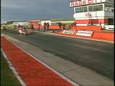 Motorsports, drag race flame red altered race Stock Footage
