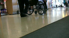 Wheelchair Being Pushed At The Airport Stock Footage