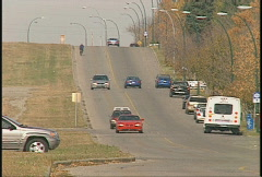 Light traffic long on quiet street in autumn, 37th St SW Calgary Stock Footage
