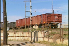 Railroad, hump track at railway yard, cars coast downhill Stock Footage