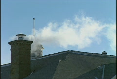 Steam rising above school roof med Stock Footage
