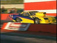 Motorsports, drag racing, yellow camaro promod launch Stock Footage