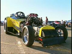 motorsports, drag racing, yellow Top fuel altered walkabout Stock Footage