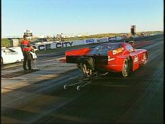Motorsports, drag racing, red vette white vette promod launch Stock Footage