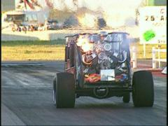 Motorsports, Drag racing! stagecoach dragster wheelstander flames  Stock Footage