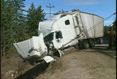 Auto accident, wrecked truck and trailer, twisty mountain highway #1 Stock Footage