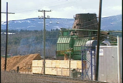 Industry, lumber beehive burner and mill, interior BC, Canada Stock Footage