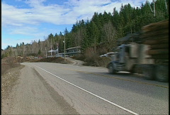 Trucking, log truck on highway Stock Footage