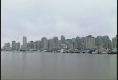 Vancouver harbour pan, sailboats and condos in the rain Stock Footage